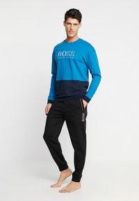 BOSS - Teplákové kalhoty - black - 1