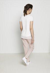 bellybutton - Spodnie treningowe - shadow gray / rose - 3
