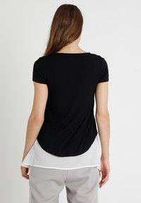 bellybutton - MIT STILLFUNKTION - Camiseta estampada - black onyx - 2
