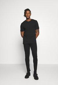 Belstaff - TATTENHALL RAVEN COAL - Slim fit jeans - rinse black - 1