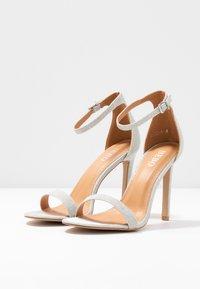 BEBO - Sandalen met hoge hak - silver shimmer - 4