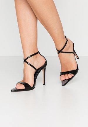 SKITTLE - Sandaler med høye hæler - black