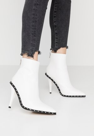 CATHY - High heeled ankle boots - white