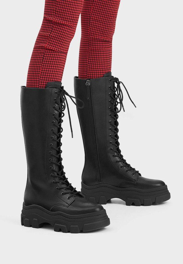 MIT PROFILSOHLE - Lace-up boots - black