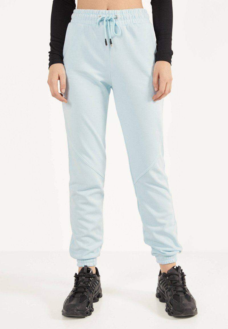 Bershka - Trainingsbroek - light blue