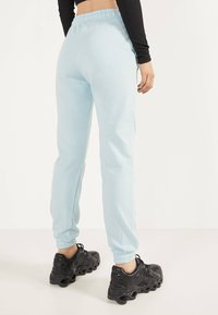 Bershka - Trainingsbroek - light blue - 2