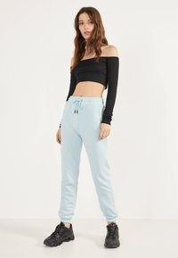Bershka - Trainingsbroek - light blue - 1