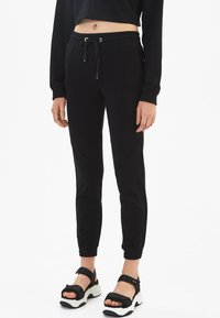 Bershka - Trainingsbroek - black - 0