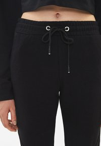 Bershka - Trainingsbroek - black - 3