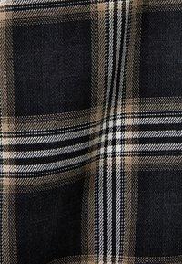 Bershka - KARIERTE - Spodnie materiałowe - black - 4