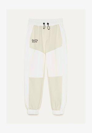 JOGGERHOSE MIT REFLEKTIERENDEM STREIFEN 00121512 - Jogginghose - white