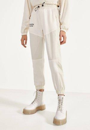 JOGGERHOSE MIT REFLEKTIERENDEM STREIFEN 00121512 - Pantalon de survêtement - white