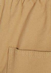 Bershka - Tracksuit bottoms - beige - 4