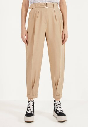 SLOUCHY - Trousers - stone