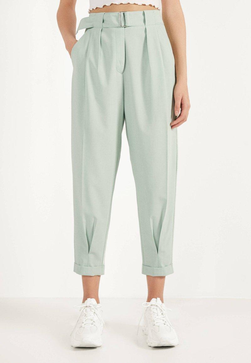 Bershka - SLOUCHY - Trousers - turquoise