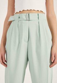 Bershka - SLOUCHY - Trousers - turquoise - 3