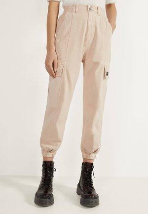 Trousers - mottled beige