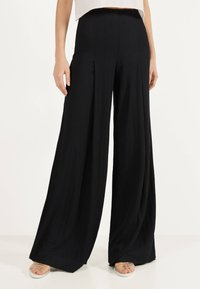 Bershka - Trousers - black - 0
