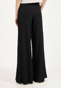Bershka - Trousers - black - 2