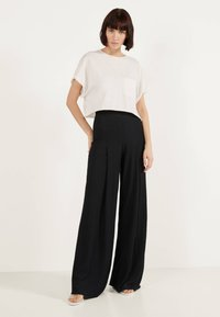 Bershka - Trousers - black - 1