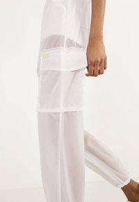 Bershka - TRANSPARENTE - Trousers - white - 3