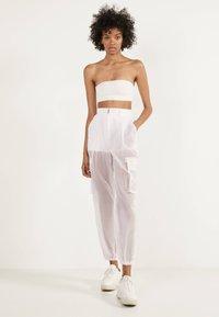Bershka - TRANSPARENTE - Trousers - white - 1