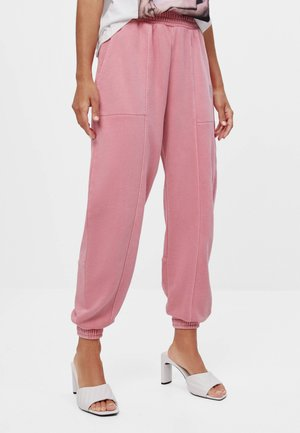 REFLEKTIERENDE - Teplákové kalhoty - pink
