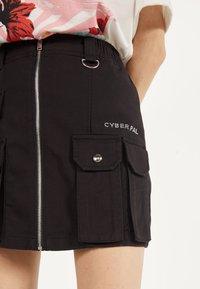 Bershka - MIT REISSVERSCHLUSS 00569019 - A-line skirt - black - 3