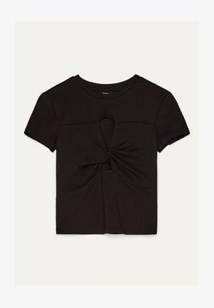 MIT SCHLITZEN UND KNOTEN  - T-Shirt print - black