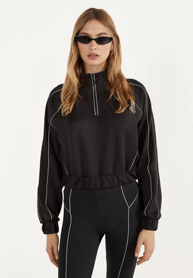 MIT REFLEKTIERENDEN DETAIL  - Sweatshirt - black