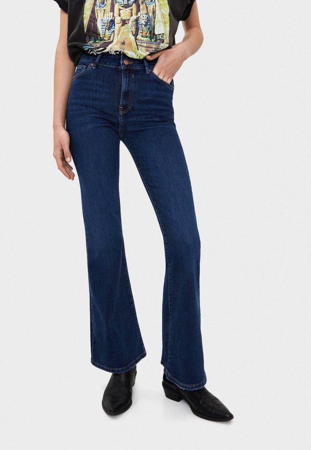 MIT SCHLAG - Jeans a zampa - dark blue