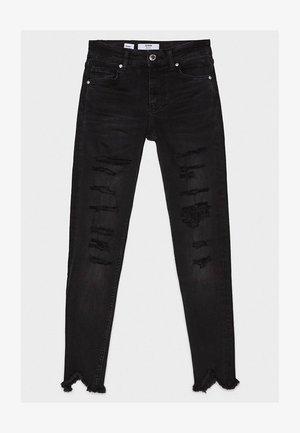 SKINNY-JEANS MIT TIEFEM BUND UND ZIERRISSEN 00013179 - Jeans Skinny Fit - black