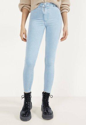 MIT HOHEM BUND UND GÜRTEL - Jeans Skinny Fit - blue denim