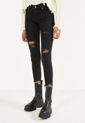 SKINNY-JEANS MIT TIEFEM BUND 00152352 - Jeans Skinny Fit - black