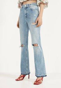 Bershka - MIT ZIERRISSEN - Flared jeans - blue denim - 0