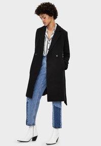 Bershka - MIT GÜRTEL - Classic coat - black - 1