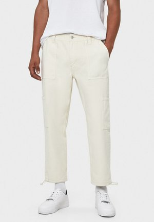 MIT STOPPERN - Straight leg jeans - beige