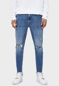 Bershka - MIT RISSEN - Jeans Skinny Fit - light blue - 0