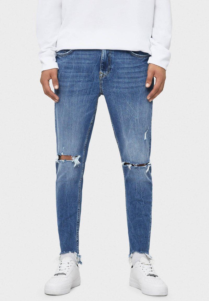 Bershka - MIT RISSEN - Jeans Skinny Fit - light blue