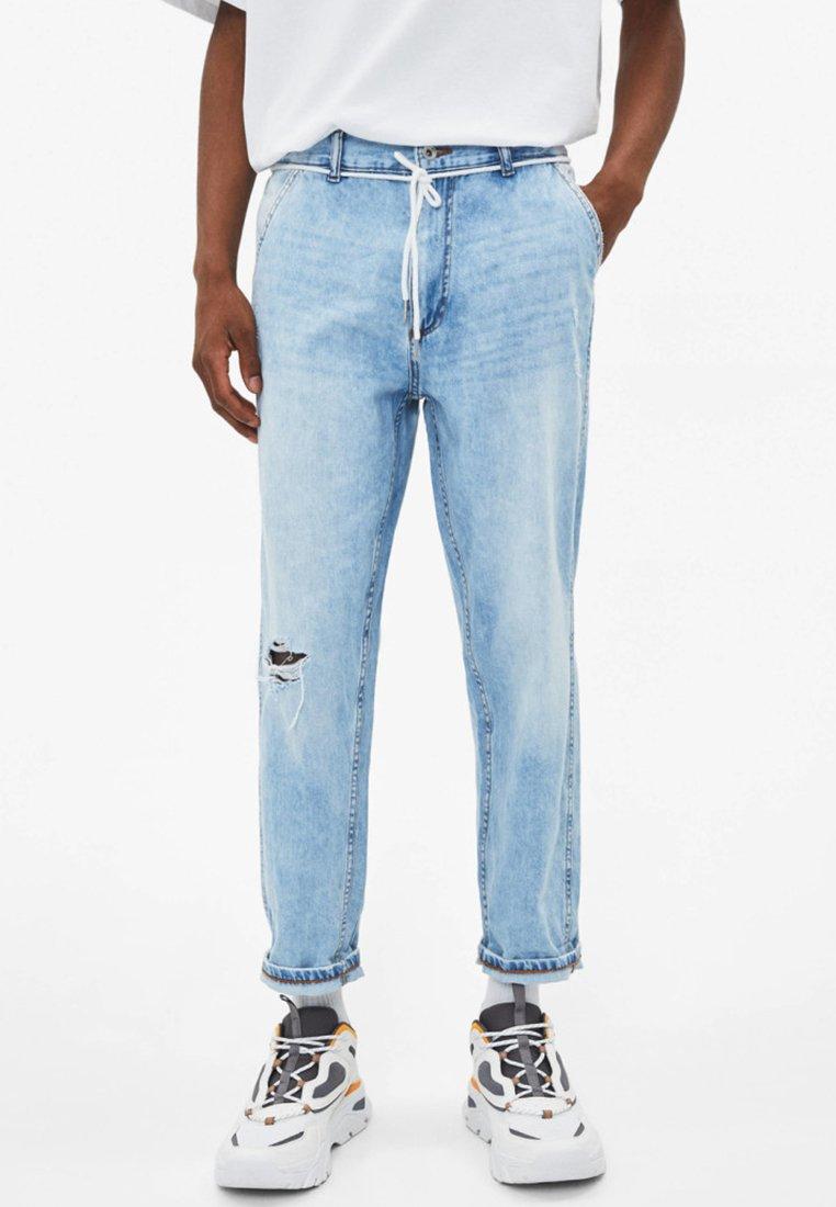 Bershka - MIT RISSEN - Straight leg jeans - light blue