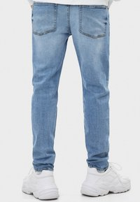 Bershka - Slim fit jeans - blue denim - 1
