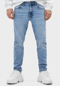 Bershka - Slim fit jeans - blue denim - 0