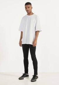 Bershka - Jeans Skinny - black - 1