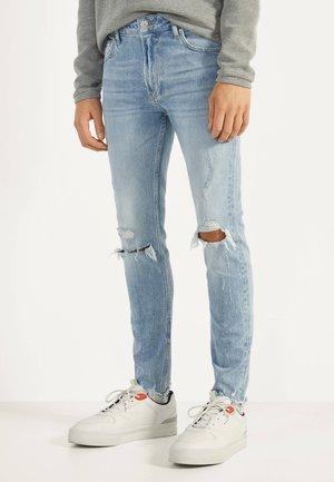 MIT RISSEN - Jeans Skinny Fit - blue