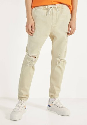 RISSEN - Jeans Tapered Fit - beige