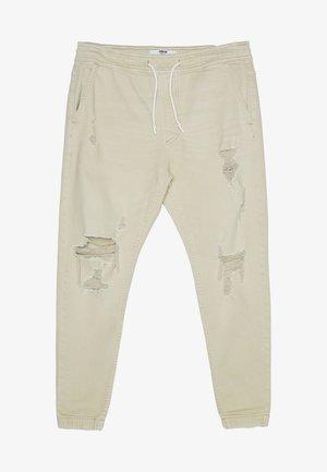 RISSEN - Zúžené džíny - beige