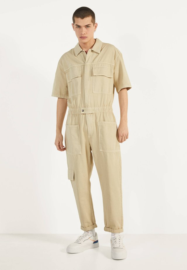 Jeansy Relaxed Fit - beige