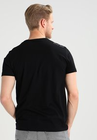 BOSS - T-shirt basique - black - 3