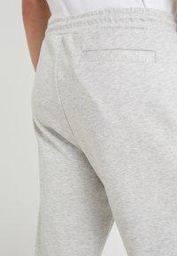 BOSS - HADIKO  - Tracksuit bottoms - light pastel grey - 3