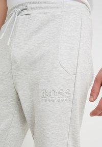 BOSS - HADIKO  - Tracksuit bottoms - light pastel grey - 5
